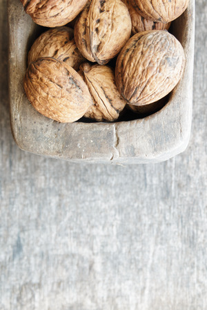 pace: Food background, walnuts on a wooden table, pace for text. Stock Photo