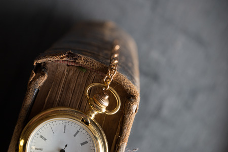 Vintage pocket watch and old book, symbols of time with copy space Stock Photo