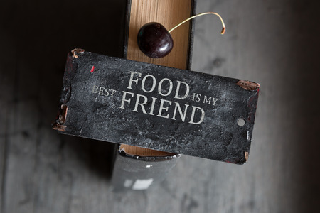 repast: Gourmand idea. Food my best friend concept. Sign with the text and cherry.