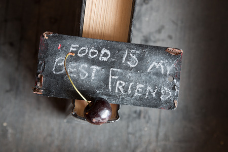 repast: Food my best friend concept. Sign with the text and cherry. Stock Photo
