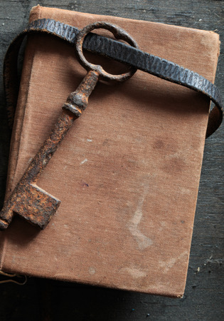 Vintage old key on the book, vintage background, Stock Photo
