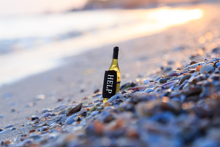 in need of space: HELP, the inscription on the bottle, sunset on the beach