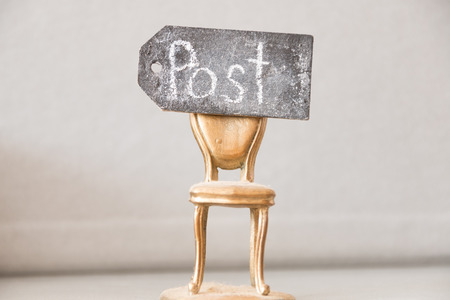 vacant: vacant post, golden chair, and an inscription in chalk post Stock Photo