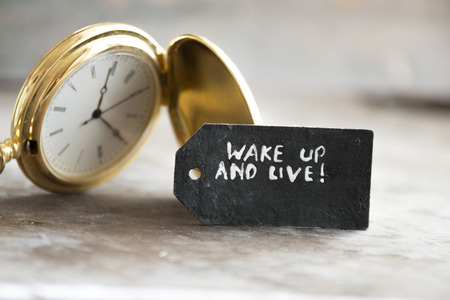 wake up and live  inscription on the label and gold pocket watch
