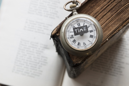 test deadline: time text and old pocket watch on the book, education, study, exam idea Stock Photo