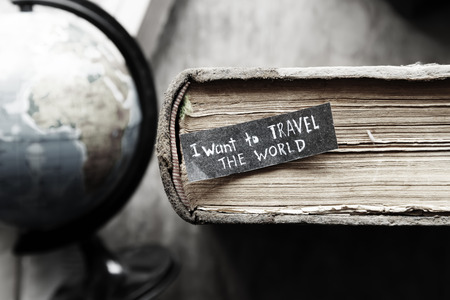 Travel idea. i want to travel the world  inscription on the label, old books and globe, Banco de Imagens