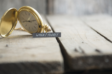 today: Today idea. Hand writing a note and gold pocket watch Stock Photo