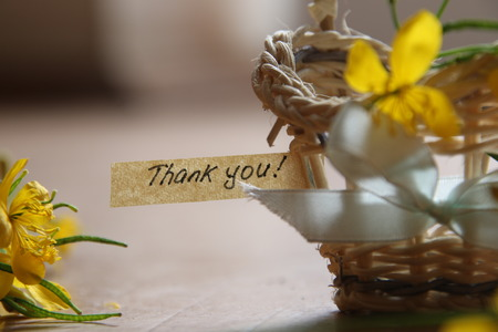thank you letter tag or label a basket of flowers Stock Photo