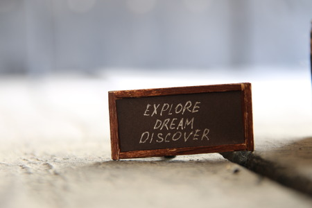 discover: Explore Dream Discover - Inspirational Travel Quote, text and vintage table