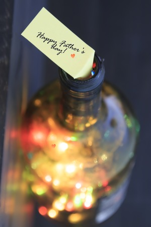 colored bottle: Happy Fathers Day idea, label and bottle with colored lights