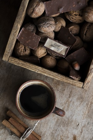 flavorsome: good morning idea - text and a cup of coffee, chocolate and nuts on the vintage table