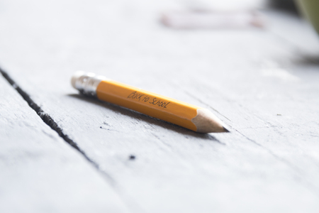 pencil on the table, Back to School - written in pencil