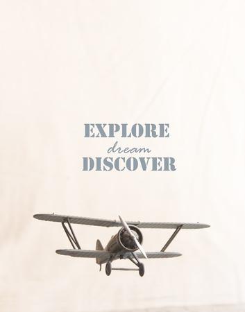 discover: explore, dream, discover - text and retro plane