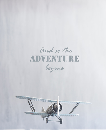 begins: And so the adventure begins text and retro plane Stock Photo
