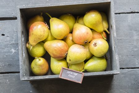 rustic food: Healthy Organic Pears on rustic background, and text healthy food