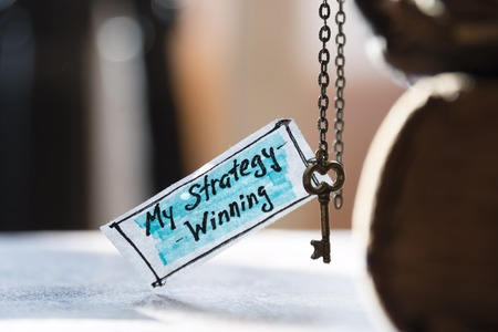 golden key: winning strategy concept - label and golden key Stock Photo