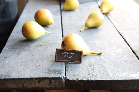 flavorful: Juicy flavorful pears on a wooden table and text healthy food