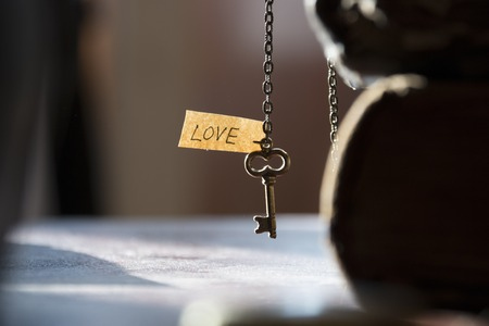golden key: love, valentines day or wedding concept, golden key with tag
