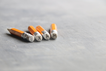exam concept, inscription on a yellow pencil Stock Photo