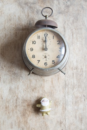 12 days of christmas: New Year 2017 greeting card, vintage alarm clock on a brown background.