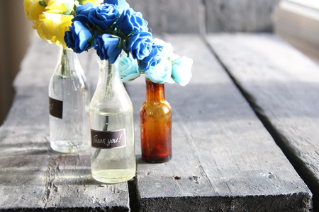 gratefulness: Thank you tag and nice flowers in the bottles Stock Photo