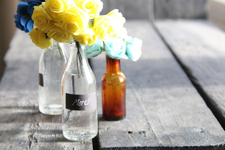 Merci idea, nice flowers in the bottles and tag Stock Photo