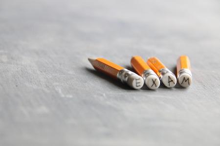 exam inscription on pencil Stock Photo