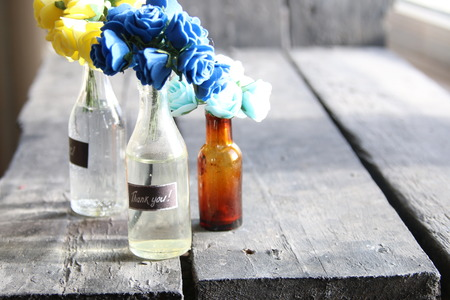 Thank you tag and beautiful flowers in the bottles