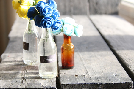 Gracias tag and nice flowers in the bottles Stock Photo