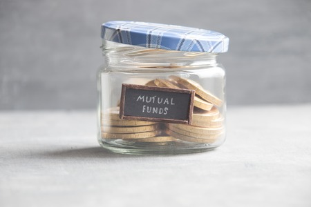 financial diversification: MUTUAL FUNDS idea - text and coins Stock Photo