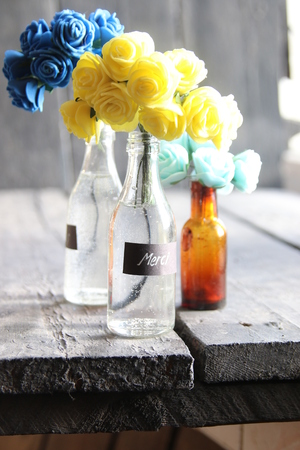 Merci tag and nice flowers in the bottles