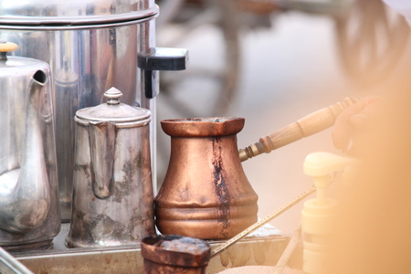 greek pot: Close up view of turkish coffee prepared on hot golden sand.