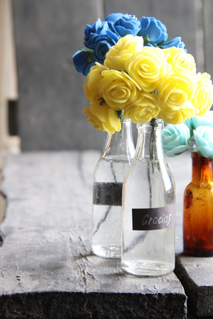 Gracias, thank you in Spanish, tag and flowers in a bottle Stock Photo