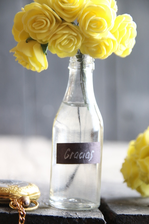 Gracias label and Flowers in a glass bottle.