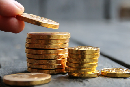income raise idea, gold coins on the table,