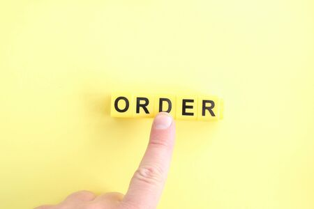 Concept for online orders and purchases. Hand clicking on an order button.