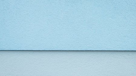 two and two thirds: Upper two-thirds blue lower third light blue, horizontally divided wall Stock Photo