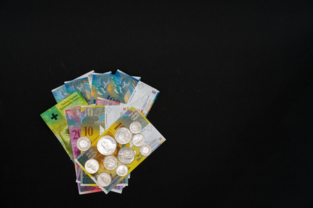 fidgety: Money arranged on black background