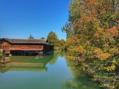 Boathouse on the brook Aabach at the historic Badeeanstalt in Robenhausen near Wetzikon, Switzerland.