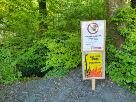 Seon, Aargau / Switzerland - April 23, 2020: Due to the failure of the rain for several weeks a sign at the edge of the forest with the following text: Do not light a fire! Forest fire risk. Éditoriale