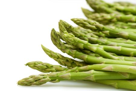 bunched: Green fresh asparagus on white background