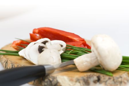 chive: Fresh mushroom with chive on a wood cutting board Stock Photo