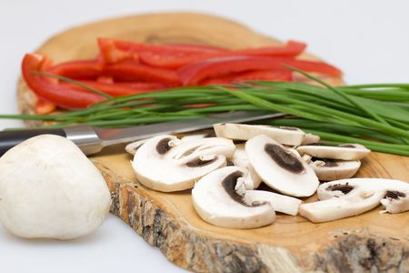 chive: Fresh mushroom with red pepper and green chive Stock Photo