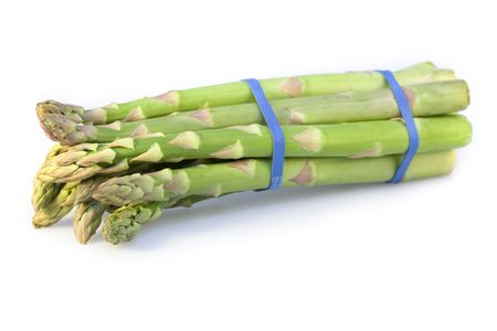 bunched: A bundle of green asparagus isolated on a white background Stock Photo