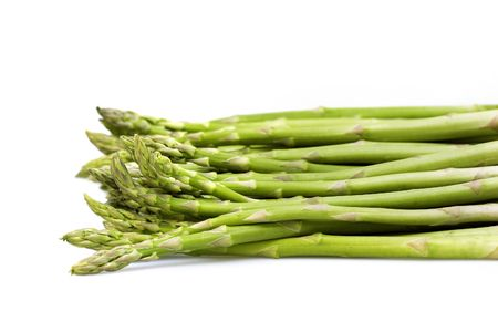 bunched: Asparagus green on white background isolated