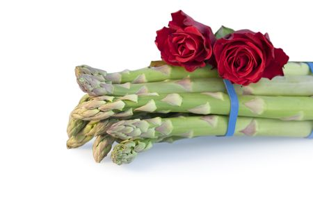 bunched: Still life of asparagus and red roses