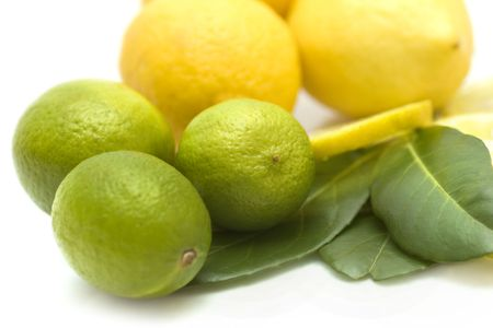 focus on the foreground: Limes und lemons with leafes,focus on foreground; close-up view