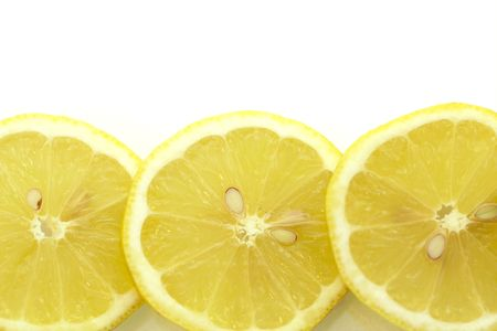 focus in foreground: three sices of lemon,focus on foreground; close-up view