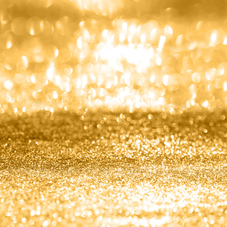 edel: Festive abstract background with shiny gold sparkle effect