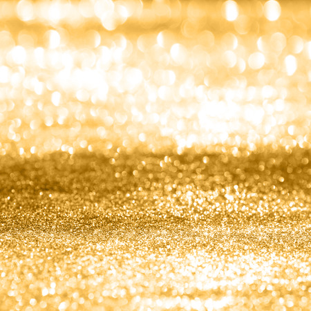 Festive abstract background with shiny gold sparkle effect